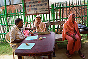 A doctor checks the blood pressure of a pregnant woman in the delivery hut in Barwa village of East Champaran district of Bihar, India. Initiated to provide better pre-natal care to the pregnant women, Duncan Hospital with collaboration with Geneva Global has initiated a special campaign - delivery hut. Villagers here are told about various health issues, women go through free pre-natal check ups etc. Since 2008 the Foundation and Geneva Global have been investing in the training of medical staff to improve the lives of people living in 600+ villages in the region. The NGOs are delivering cost effective interventions to address treatment, care and prevention of diseases, disability and preventable deaths amongst infants, adolescent girls and women of child-bearing age. There is statistical and anecdotal evidence that there have been vast improvements and a total of 40-50% increased immunization for all children under 6 has meant that communities can be serviced and educated long term. Photograph: Sanjit Das/Panos for Legatum Foundation