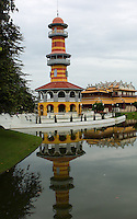 The island of Bang Pa-In, about 45 miles north of Bangkok, has been a summer royal retreat since 1632 and, in the late 19th century, King Rama V erected there a palace composed of a Chinese pagoda, a Swiss chalet, a boat-house and numerous baroque pavilions, all set in expansive gardens and lakes.