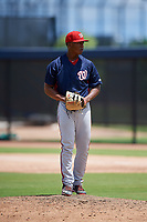 GCL Nationals relief pitcher Joan Adon (44) gets ready to deliver a pitch during a game against the GCL Astros on August 6, 2018 at FITTEAM Ballpark of the Palm Beaches in West Palm Beach, Florida.  GCL Astros defeated GCL Nationals 3-0.  (Mike Janes/Four Seam Images)