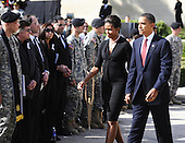 Fort Hood, TX - November 10, 2009 -- U.S. President Barack Obama and First Lady Michelle Obama walk to their seats as they arrive for the memorial service for the 12 soldiers and one civilian killed at Fort Hood U.S Army Post near Killeen, Texas, USA 10 November 2009. Army Major Malik Nadal Hasan reportedly shot and killed 13 people, 12 soldiers and one civilian, and wounded 30 others in a rampage 05 November at the base's Soldier Readiness Center where deploying and returning soldiers undergo medical screenings.  .Credit: Tannen Maury / Pool via CNP