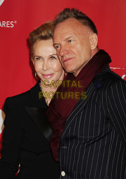 Trudie Styler & Sting (Gordon Sumner).At the 2013 MusiCares Person Of The Year at Los Angeles Convention Center in Los Angeles, California, USA,.8th February 2013..half length blazer married husband wife red burgundy scarf navy blue pinstripe jacket .CAP/ROT/TM.©Tony Michaels/Roth Stock/Capital Pictures