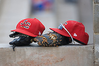 Johnson City Cardinals hats and gloves sit in the visitors dugout at Dan Daniels Park in Danville, VA, Sunday July 27, 2008.