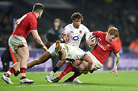 Rhys Patchell of Wales is tackled to ground. Natwest 6 Nations match between England and Wales on February 10, 2018 at Twickenham Stadium in London, England. Photo by: Patrick Khachfe / Onside Images