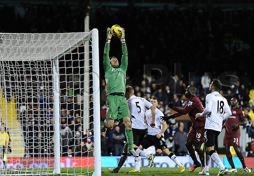 10.12.2012 London, England. Mark Schwarzer of Fulham saves a high cross in the box during the Premier League game between Fulham and Newcastle United from Craven Cottage.
