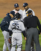 New York Yankees manager Joe Girardi (28) has a conference on the mound with pitcher C.C. Sabathia (52) in the second inning against the Baltimore Orioles at Oriole Park at Camden Yards in Baltimore, MD on Thursday, April 11, 2012.  .Credit: Ron Sachs / CNP.(RESTRICTION: NO New York or New Jersey Newspapers or newspapers within a 75 mile radius of New York City)