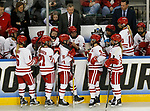 ST CHARLES, MO - MARCH 19:  Members of the Wisconsin Badgers discuss strategy at the Wisconsin bench during the Division I Women's Ice Hockey Championship held at The Family Arena on March 19, 2017 in St Charles, Missouri. Clarkson defeated Wisconsin 3-0 to win the national championship. (Photo by Mark Buckner/NCAA Photos via Getty Images)