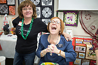 NWA Democrat-Gazette/CHARLIE KAIJO Rhonda Guinn, instructor at the Rogers Sewing Center (from left) and Kellie Rushing instructor with OESD of Fortworth, TX laugh, Friday, March 16, 2018 at the Rogers Sewing Center in Rogers. <br /><br />The Oklahoma Embroidery Supply &amp; Design hosted an informational class where participants learned about embroidery tips and techniques. About 40 people attended the day's event. The event will continue on Saturday from 10-4pm