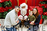 Nicky and Bobby O'Sullivan and Sarah Wharton from Ardfert visiting Santa Claus in the Manor West Shopping Centre on Saturday.