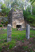 A stone lime kiln located off of the Chippewa Trail near Black Mountain in Haverhill, New Hampshire USA during the summer months. This kiln was built in the early 1800s.