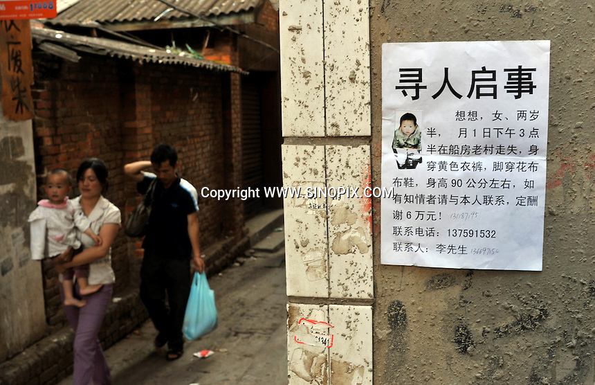 A sign for a missing girl in a migrant area known for child abductions in the suburbs of Kunming city.  Girls in China are increasingly targeted and stolen as there is a shortage of wives as the gender imbalance widens with 120 boys for every 100 girls..PHOTO BY SINOPIX
