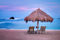 Beach and chairs with sunrise at Four Seasons. Punta Mita, Mexico.