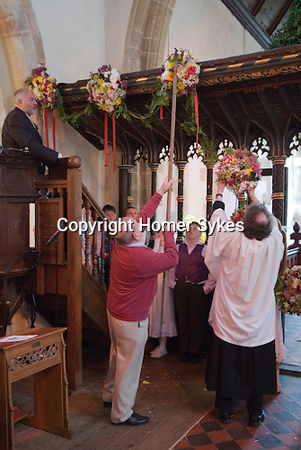Charlton-on-Otmoor Oxfordshire Ist of May Day Celebrations. Children from the Church of England St Mary the Virgin Primary School process to the village church to have their May garlands blessed. The garlands are then hung on the church Rood Screen. 2014.