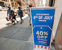 The Gap advertises their 4th of July sales in New York on Monday, July 4, 2016.  (© Richard B. Levine)