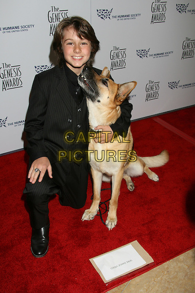 DOMINIC SCOTT KAY & ABBEY THE DOG.22nd Annual Genesis Awards held at the Beverly Hilton Hotel,  Beverly Hills, California, USA,  29 March 2008..full length black suit kneeling crouching dog animal pet .CAP/ADM/RE.©Russ Elliot/Admedia/Capital PIctures