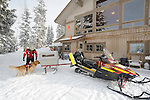 Vail Mountain's ski patroman Ben Kurtz loads avalanche rescue dog, Henry, a Labroador, onto a snow mobile for a training run in Vail's back bowls.