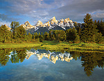 USA; Wyoming, Grand Teton National Park.   Grand Tetons reflecting in the Snake River.