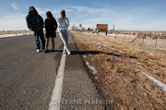 Trent Nelson  |  The Salt Lake Tribune.Ariel Losee, Elvia Lopez and Eliseo Mancinas, friends of slain Millard County Sheriff Deputy Josie Fox, pay their respects at the seen of the shooting Tuesday, January 5, 2010.