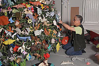 Details of tree and decoration process. Talo Kawasaki placing models on the tree.