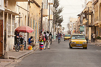 Senegal, Saint Louis.  Street Scene, Taxis, People.