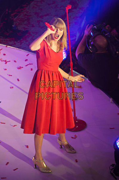 Taylor Swift.at Westfield London shopping centre to switch on Christmas Lights, London, England..6th November 2012.on stage in concert live gig performance performing music full length red dress  singing .CAP/BF.©Bob Fidgeon/Capital Pictures.