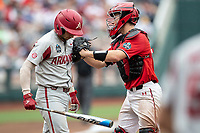 Texas Tech Red Raiders catcher Braxton Fulford (26) tag out Dominic Fletcher (24) during Game 5 of the NCAA College World Series against the Arkansas Razorbacks on June 17, 2019 at TD Ameritrade Park in Omaha, Nebraska. Texas Tech defeated Arkansas 5-4. (Andrew Woolley/Four Seam Images)
