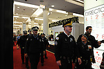 Police follow out a small crowd of protesters calling on Chicago Mayor Rahm Emanuel to resign briefly entered Macy's in the Loop, Chicago, Illinois on December 9, 2015.  Emanuel offered a historic apology for the police killing of Laquan McDonald and police brutality and racial profiling generally -- without using those words -- in front of the City Council in the morning.