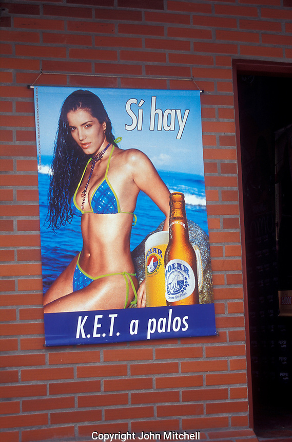 Poster advertising Polar beer outside a restaurant and bar in Caracas, Venezuela