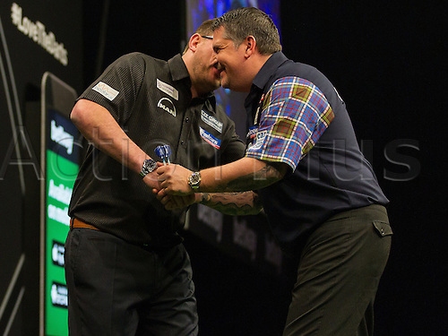 31.03.2016. The Motorpoint Arena, Cardiff.  Betway PDC Premier League Darts Judgement Night. Gary Anderson and James Wade share a joke
