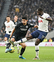 26th December 2019; Tottenham Hotspur Stadium, London, England; English Premier League Football, Tottenham Hotspur versus Brighton and Hove Albion; Steven Alzate of Brighton & Hove Albion controls the ball with Moussa Sissoko of Tottenham Hotspur stretching for the ball - Strictly Editorial Use Only. No use with unauthorized audio, video, data, fixture lists, club/league logos or 'live' services. Online in-match use limited to 120 images, no video emulation. No use in betting, games or single club/league/player publications