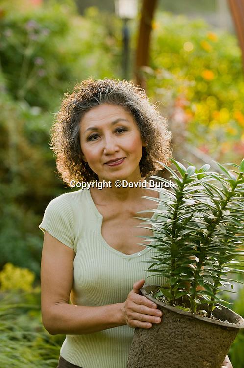 Asian woman enjoying, gardening