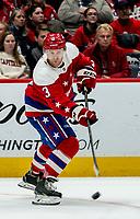 WASHINGTON, DC - JANUARY 31: Nick Jensen #3 of the Washington Capitals  makes a pass during a game between New York Islanders and Washington Capitals at Capital One Arena on January 31, 2020 in Washington, DC.