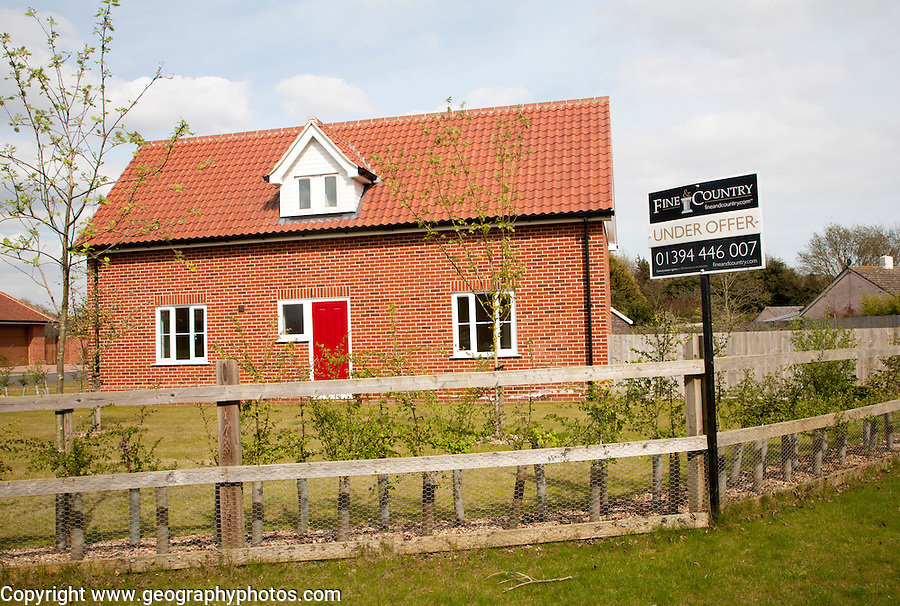 Fine and Country estate agent Under Offer outside modern house, Suffolk, England