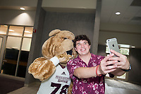 Dawg Days URec- costumed Bully poses for a selfie with a student.<br />  (photo by Megan Bean / &copy; Mississippi State University)