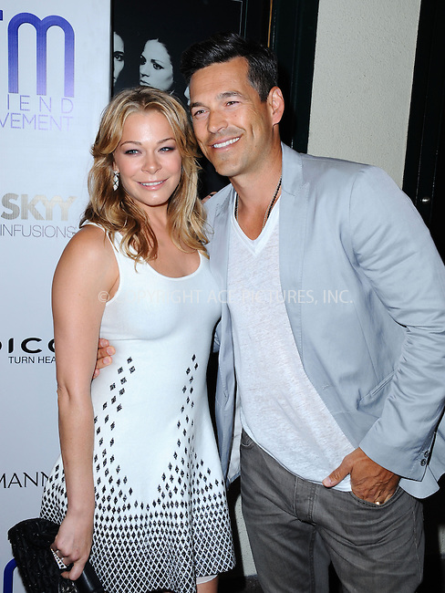 WWW.ACEPIXS.COM<br /> <br /> July 1 2013, LA<br /> <br /> Singer LeAnn Rimes and Eddie Cibrian at the Friend Movement Campaign benefit concert at the El Rey Theatre on July 1, 2013 in Los Angeles, California<br /> <br /> By Line: Peter West/ACE Pictures<br /> <br /> <br /> ACE Pictures, Inc.<br /> tel: 646 769 0430<br /> Email: info@acepixs.com<br /> www.acepixs.com