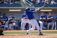 Rancho Cucamonga Quakes Omar Estevez (21) follows through on his swing against the Lake Elsinore Storm at LoanMart Field on April 22, 2018 in Rancho Cucamonga, California. The Storm defeated the Quakes 8-6.  (Donn Parris/Four Seam Images)
