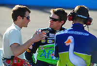 Apr 10, 2008; Avondale, AZ, USA; NASCAR Sprint Cup Series driver Kasey Kahne (left) talks with Carl Edwards during qualifying for the Subway Fresh Fit 500 at Phoenix International Raceway. Mandatory Credit: Mark J. Rebilas-
