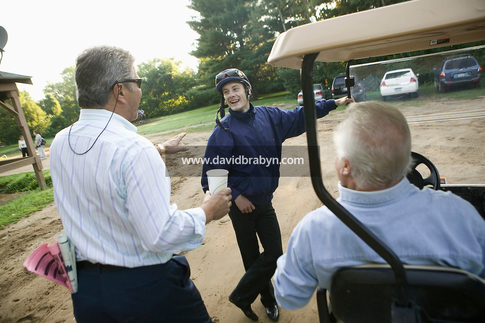 Jockey Julien Leparoux (C) jokes with horse owners visiting the Biancone stable in Saratoga Springs, NY, United States, after the early morning practice rides, 5 August 2006. Photo credit: David Brabyn.<br />