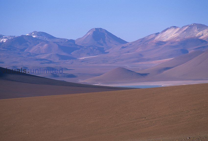 Volcanic terrain and a salt lake high ,15,000 feet, in the Altiplano, Chile.