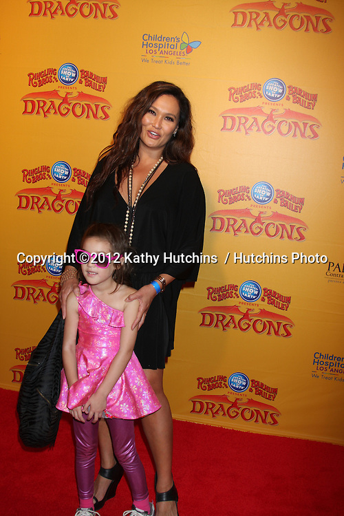 LOS ANGELES - JUL 12:  Tia Carrere arrives at 'Dragons' presented by Ringling Bros. & Barnum & Bailey Circus at Staples Center on July 12, 2012 in Los Angeles, CA