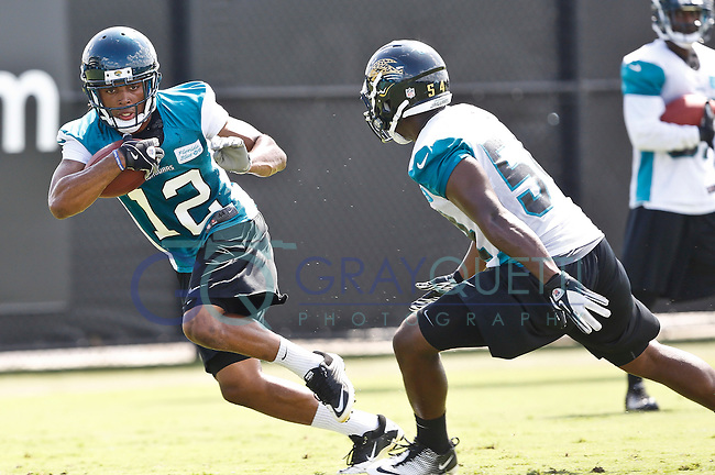 July 27, 2012:   Jacksonville Jaguars wr Mike Brown (12) works on punt returns during practice at the Jaguars training camp on the Florida Blue Health & Wellness Practice Fields outside of EverBank Field in Jacksonville, Florida.  .............