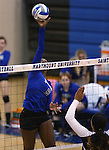Marymount's Morgan McAlpin tips during a college volleyball match against  PSU Harrisburg at Marymount University in Arlington, Vir., on Wednesday, Oct. 9, 2013.<br /> Photo by Cathleen Allison
