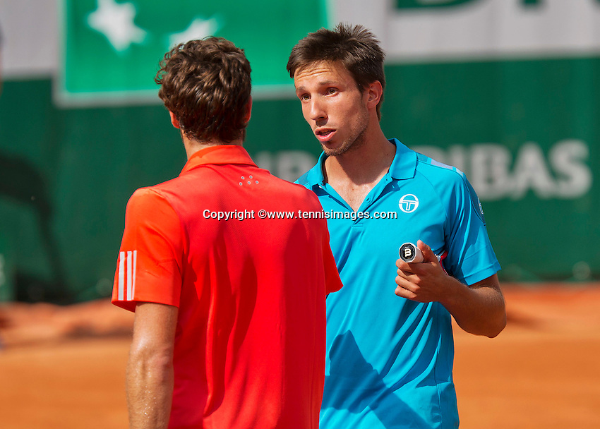 France, Paris , May 24, 2015, Tennis, Roland Garros, Igor Sijsling (NED) (R) congratulates winner Ernest Gulbis (LAT)<br /> Photo: Tennisimages/Henk Koster