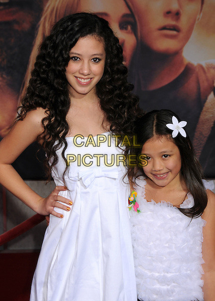 "KEANA TEXEIRA of The G-Girlz & SOPHIE TEXEIRA.""Race to Witch Mountain"" Los Angeles Premiere at the El Capitan Theatre, Hollywood, California, USA..March 11th, 2009.half length dress hand on hip sisters siblings family frills flower in hair white .CAP/ADM/BP.©Byron Purvis/AdMedia/Capital Pictures."