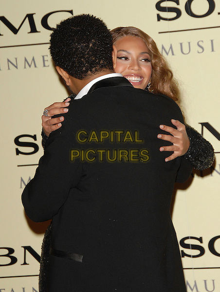 JOHN LEGEND & BEYONCE KNOWLES.attends The Sony / BMG Post Grammy Party held at The Beverly Hills Hotel in Beverly Hills, California, USA, February 11 2007..half length hugging embracing.CAP/DVS.©Debbie VanStory/Capital Pictures