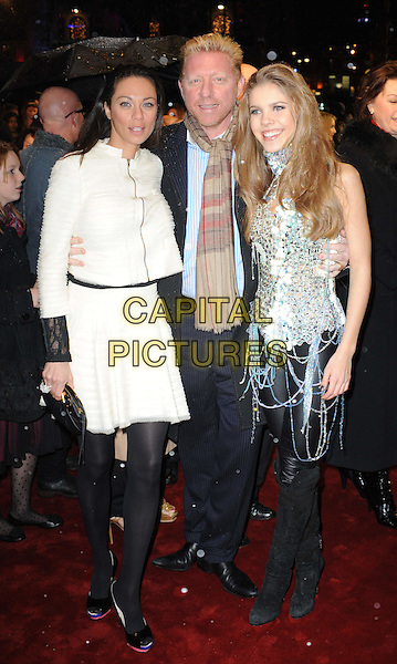 "SHARLELY ""LILLY"" KERSSENBERG, BORIS BECKER & VICTORIA SWAROVSKI.The Royal Film Performance 2010: The World Premiere of ""Chronicles of Narnia: The Voyage of the Dawn Treader"" at the Odeon, Leicester Square, London, England,.November 30th 2010..full length black tights white jacket suit beige scarf blue shirt married husband wife.CAP/WIZ.© Wizard/Capital Pictures.."