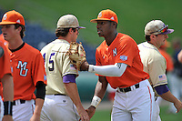 Center fielder Kyle Lewis (20) of the Mercer Bears shakes hands with Caleb Robinson (15) after winning a SoCon Tournament game against Western Carolina on Saturday, May 28, 2016, at Fluor Field at the West End in Greenville, South Carolina. Mercer won, 9-8. (Tom Priddy/Four Seam Images)