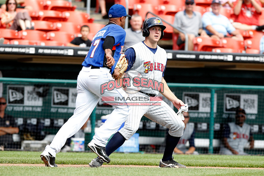 Toledo Mudhens designated hitter Scott Thorman #50 is tagged out by pitcher Miguel Batista #47 in a run down during a game against the Buffalo Bisons at Coca-Cola Field on August 17, 2011 in Buffalo, New York.  Buffalo defeated Toledo 4-2.  (Mike Janes/Four Seam Images)