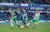 Myles Weston of Wycombe Wanderers fights through Alex Lacey (left) & Ben Whitfield of Yeovil Town during the Sky Bet League 2 match between Wycombe Wanderers and Yeovil Town at Adams Park, High Wycombe, England on 14 January 2017. Photo by Andy Rowland / PRiME Media Images.