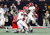 January 8th 2018, Atlanta, GA, USA;  Georgia Bulldogs linebacker Roquan Smith (3) brings down Alabama Crimson Tide running back Josh Jacobs (8) during the College Football Playoff National Championship Game between the Alabama Crimson Tide and the Georgia Bulldogs on January 8, 2018 at Mercedes-Benz Stadium in Atlanta, GA.