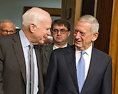 United States Senator John McCain (Republican of Arizona), Chairman, US Senate Committee on Armed Services, left, escorts US Marine Corps General James N. Mattis (retired), right, into the room as committee holds a confirmation hearing on Mattis' nomination to be Secretary of Defense on Capitol Hill in Washington, DC on Thursday, January 12, 2017.<br /> Credit: Ron Sachs / CNP